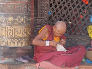 Buddhist monk in Boudhanath.  Kathmandu, Nepal. October 2012.