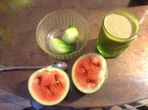 "Calvin's healthy breakfast with a ""green"" smoothie made of kale, yogurt, juice and bananas.  Then a bit of watermelon and cucumber on the side."