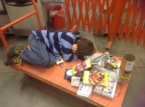 My son.  Worn out by the grow light shopping marathon.