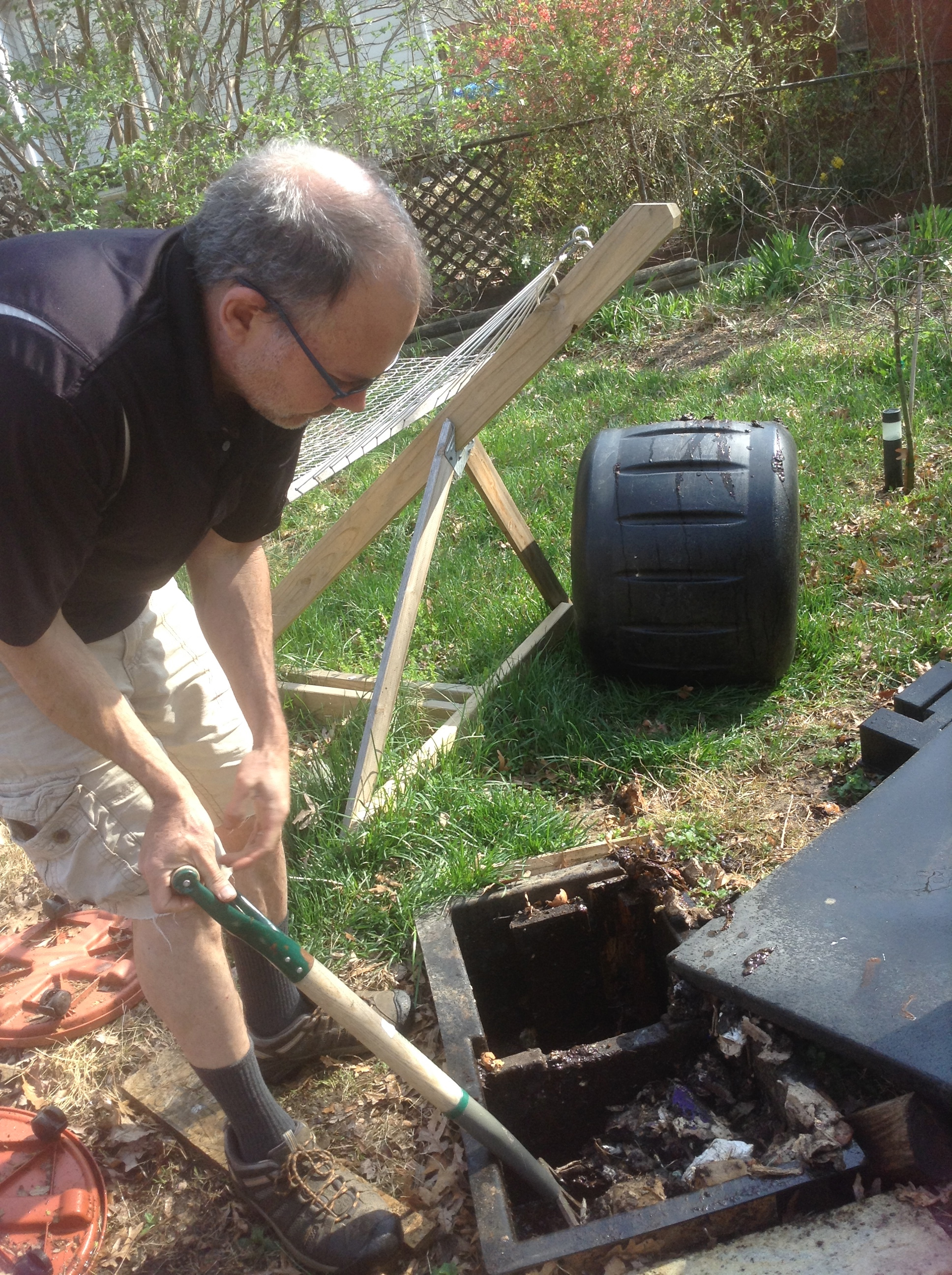 rotating the compost from holding bin to envirocycle composted